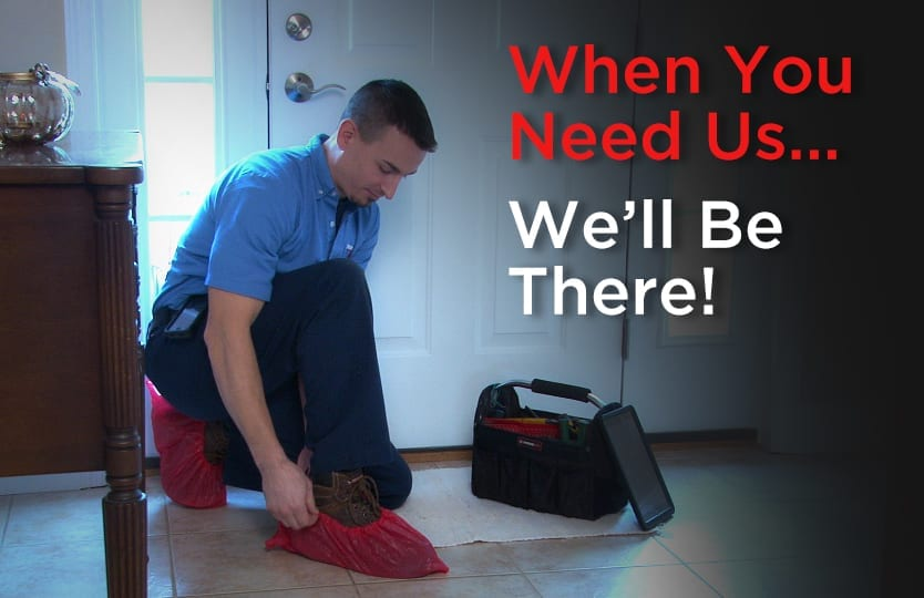 plumber putting on shoe covers client house