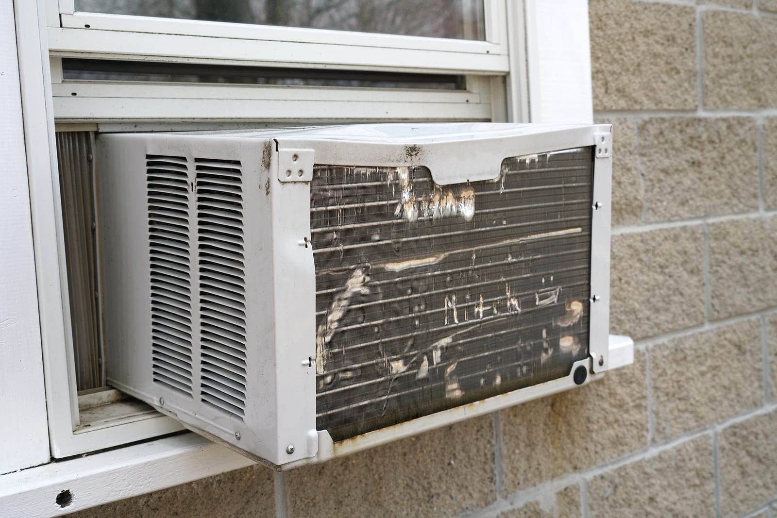 Old air conditioner installed on the window