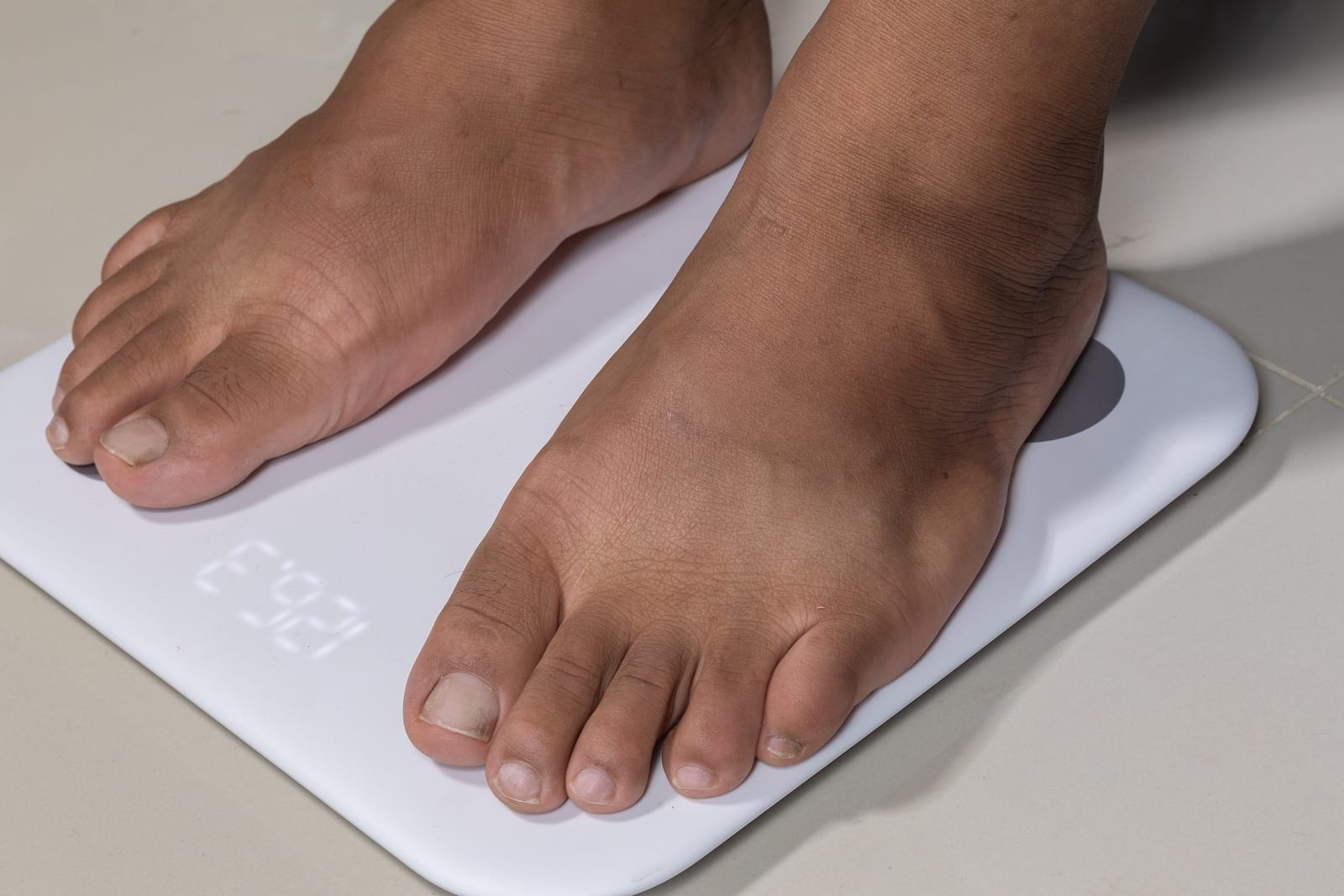 close up of man feet and digital smart scale