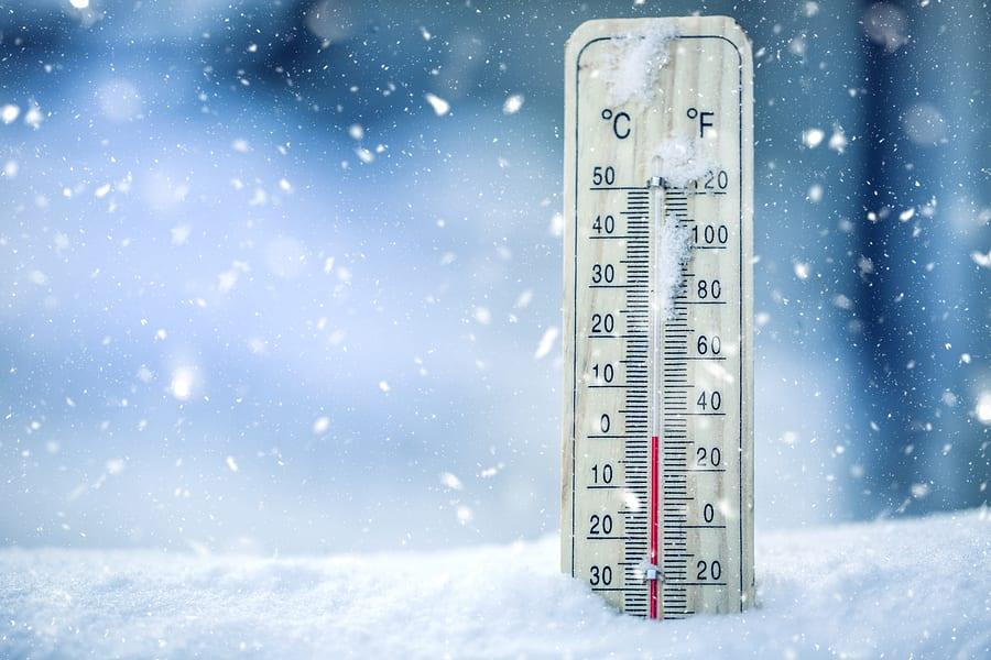 Thermometer On Snow Shows Low Temperatures - Zero. Low Temperatu