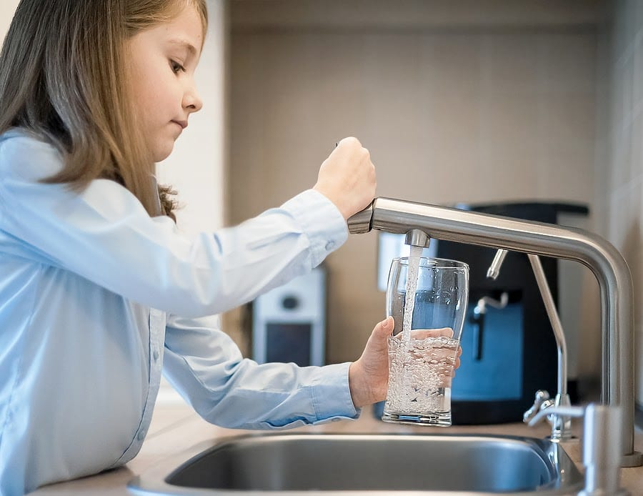 Girl Getting Water from a Faucet
